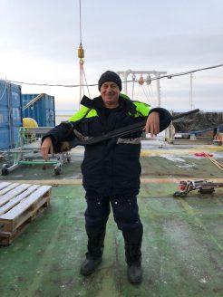 Oceanographer Vladimir Bogdanov getting ready to go on bear guard duty.