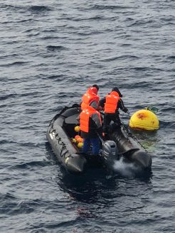 PhD Student Till Baumann and two ship crew members using a Zodiac, a rubber boat, to collect the small weights and thermistors.