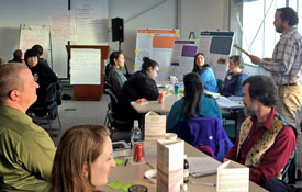 Cost (standing) shares observations and outcomes from collaborative conversations about community as part of the Northern Alaska Scenarios Project in Barrow, Alaska. (Photo by B. Blair)