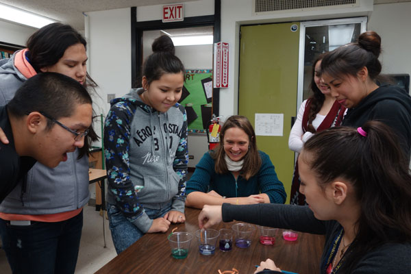 """Under Hauri's guidance, high school students perform an """"ocean acidification in a cup"""" experiment during Bering Sea Days in St. Paul, Alaska. (Photo by P. Freeman)"""