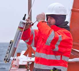 Rember attaches an SBE 37 microcat, for measuring temperature, salinity, and pressure, to a mooring line during the 2013 Akademic Fedorov NABOS research cruise. (Photo: I. Goszczko)