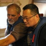 Zhang (right) and his colleague examine dropsonde observations on board the National Oceanic and Atmospheric Administration (NOAA) aircraft WP-3D, over the Chukchi Sea. A dropsonde was used to measure the atmospheric vertical profile. (Photo by M. Wang)