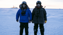Rob Rember and Marc Oggier pose in front of Polarstern during MOSAiC.