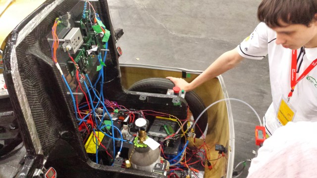 The hydrogen tank mounted in the back of the car.