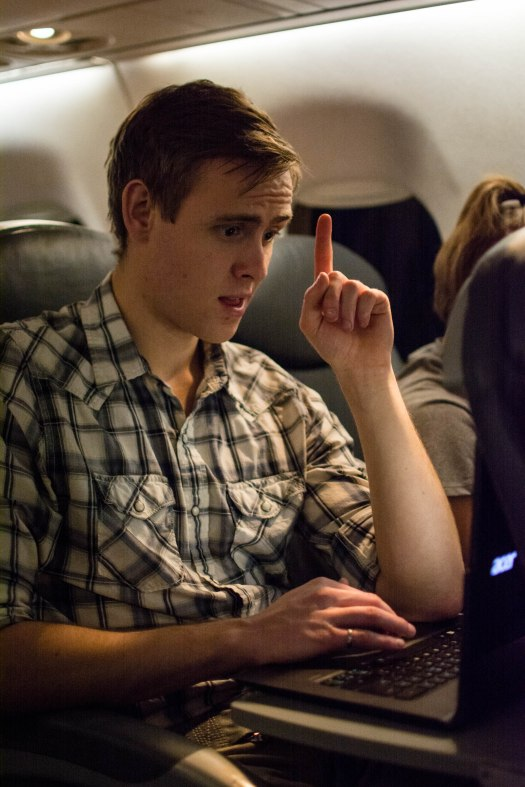 Electrical co-lead Michael Bardwell reviews some code on the plane.