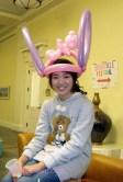 Balloon hat with bunny ears and a teddy bear.