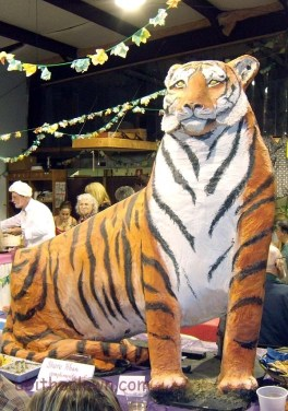 The paper mache tigers appeared courtesy of the Carolina Tiger Rescue organization, which isn't far from the where the party was held.