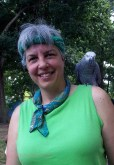Karen with Calliope, an African Gray parrot who spent the day at the park.