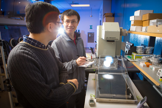 In the research lab with Sunny Clean Water in Davis Hall.Photographer: Douglas Levere