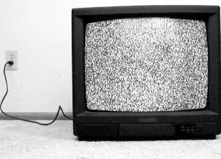 stock-footage-an-old-television-from-the-s-turned-on-with-only-static-appearing-on-the-screen
