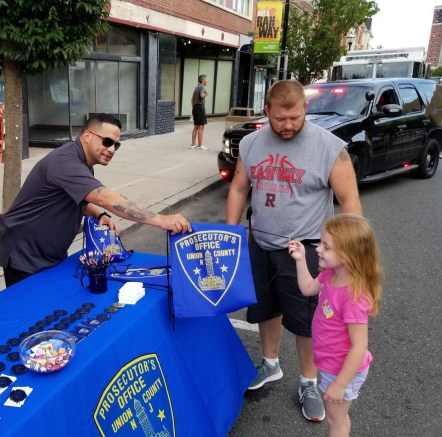 Veteran Outreach Liaison and Staff Sergeant in the U.S. Army, Detective Jorge Rios recruiting junior detectives at an outreach event