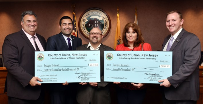 FREEHOLDER Al Mirabella, Freeholder Chairman Sergio Granados, and (far right) Freeholder Chris Hudak present Infrastructure and Level the Playing Field Checks totaling more than $100,000 for playground and various improvements to Kenilworth Mayor Anthony DeLuca, and Councilwoman Kay Ceceri.