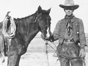 Aldo Leopold as a young man holding a horse.