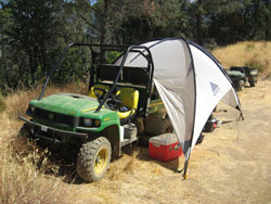 Heat wave research can be meltingly hot, so Shuldman always sets up a shade tent. The Gator helps transport water supplies and heavy equipment to the research site. Photo courtesy of Michal Shuldman.
