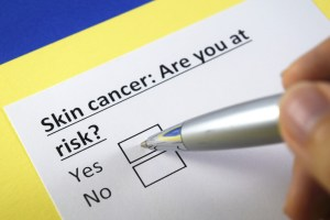 "paper with the following: ""Skin cancer: Are you at risk? Yes or no"""