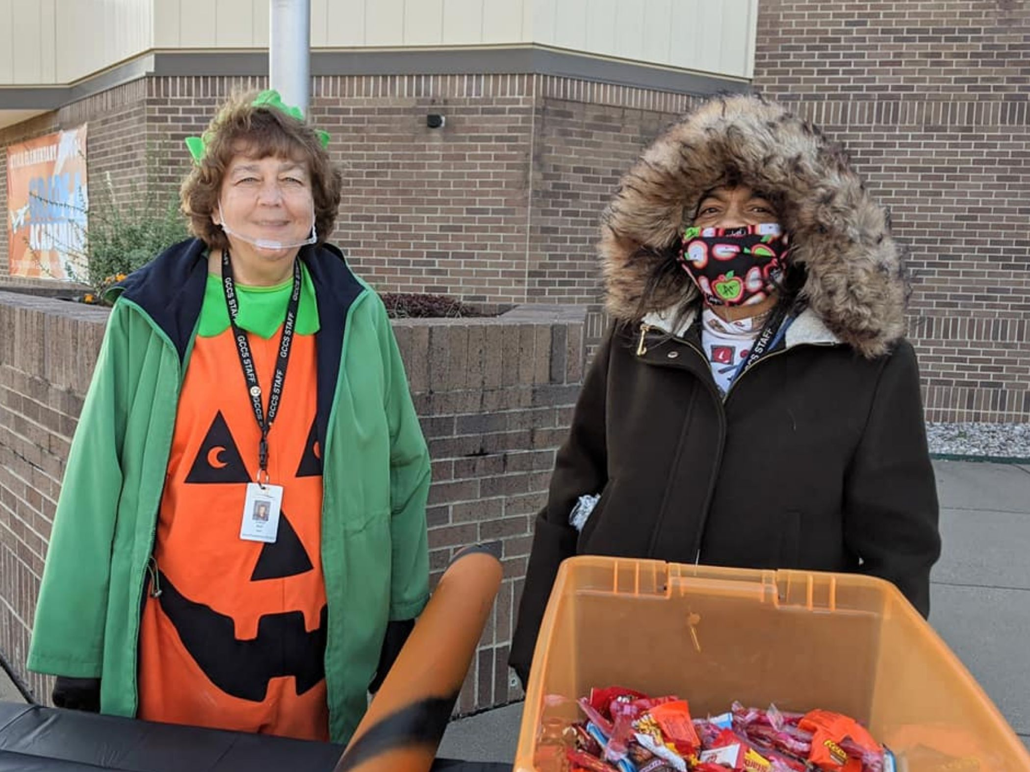 Staff members prepare to hand out candy