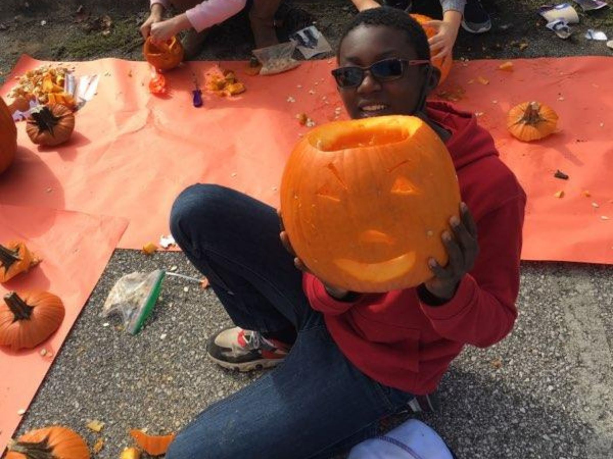 Happy student with carved pumpkin