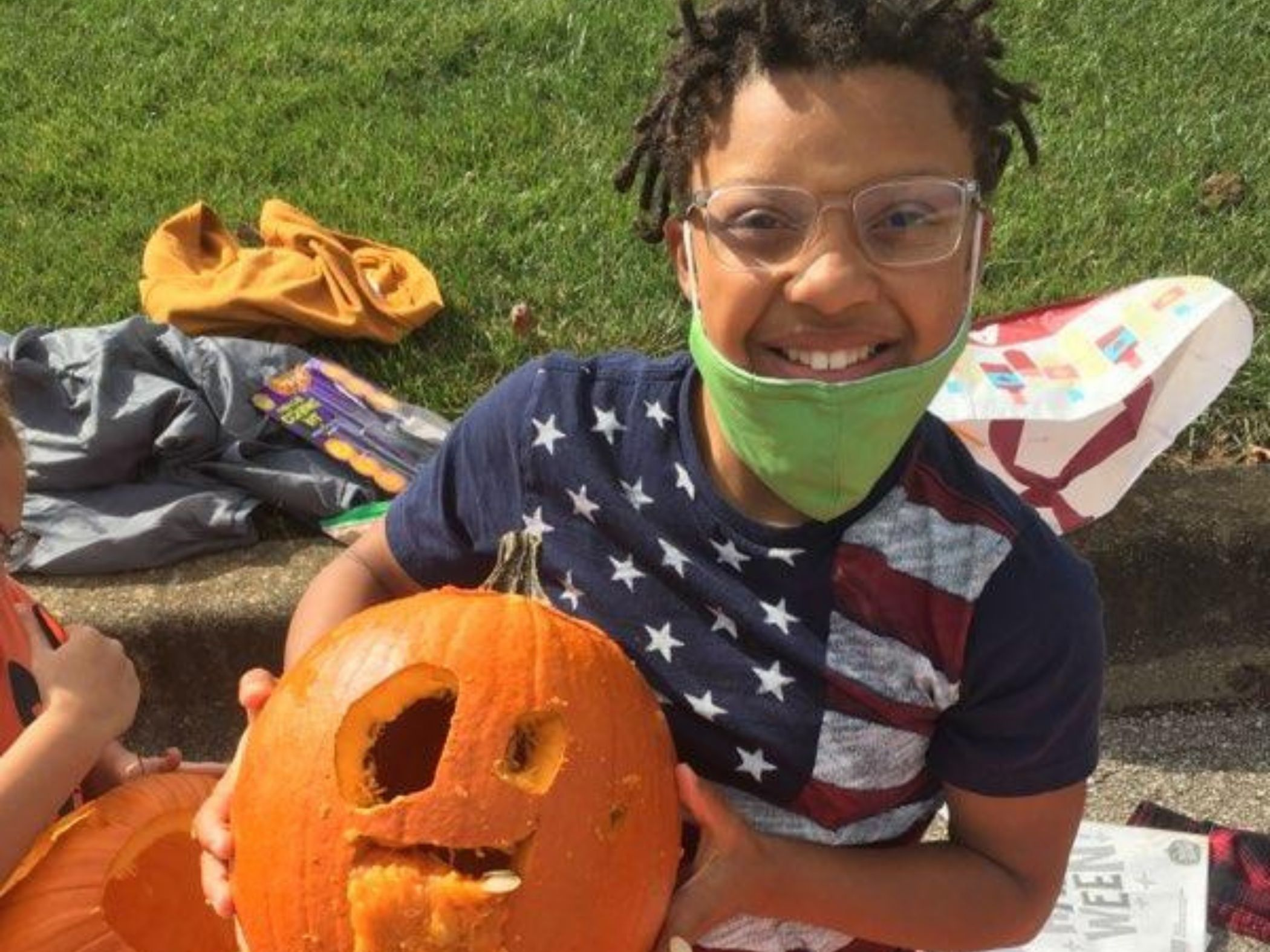 Student with carved pumpkin