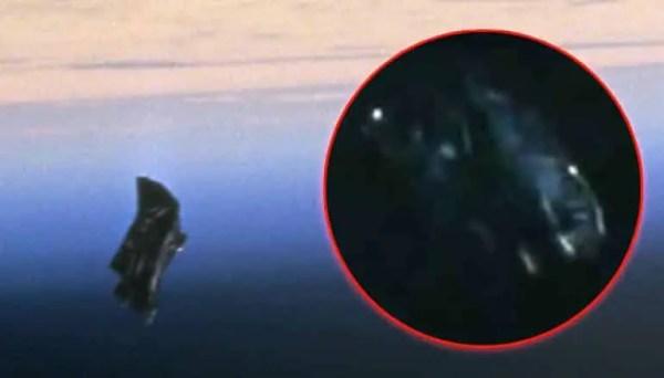 UFO Expert Says NASA Apollo 10 Photo Shows Alien Dark