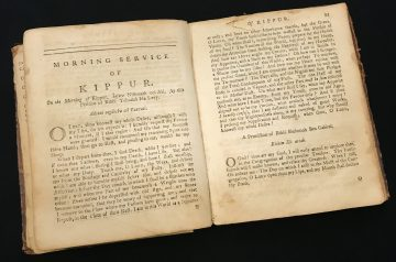 """Photo of prayer book translated by Isaac Pinto open to page that reads """"Morning Service of Kippur"""""""
