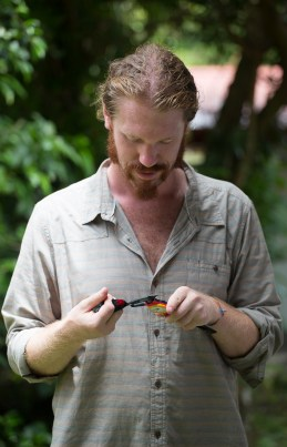 Ornithologist Cody Cox measures a long-tailed manakin on the campus of the University of Georgia in Costa Rica on Wednesday, June 22, 2016. (Photo/Rachel Eubanks, www.rachel-eubanks.com)