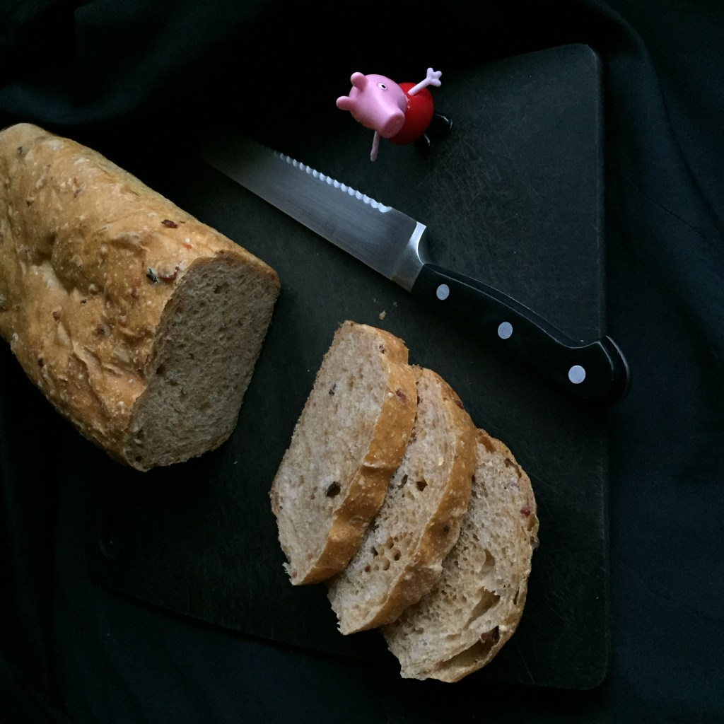 a loaf ofsweet potato sourdough and a small Peppa pig