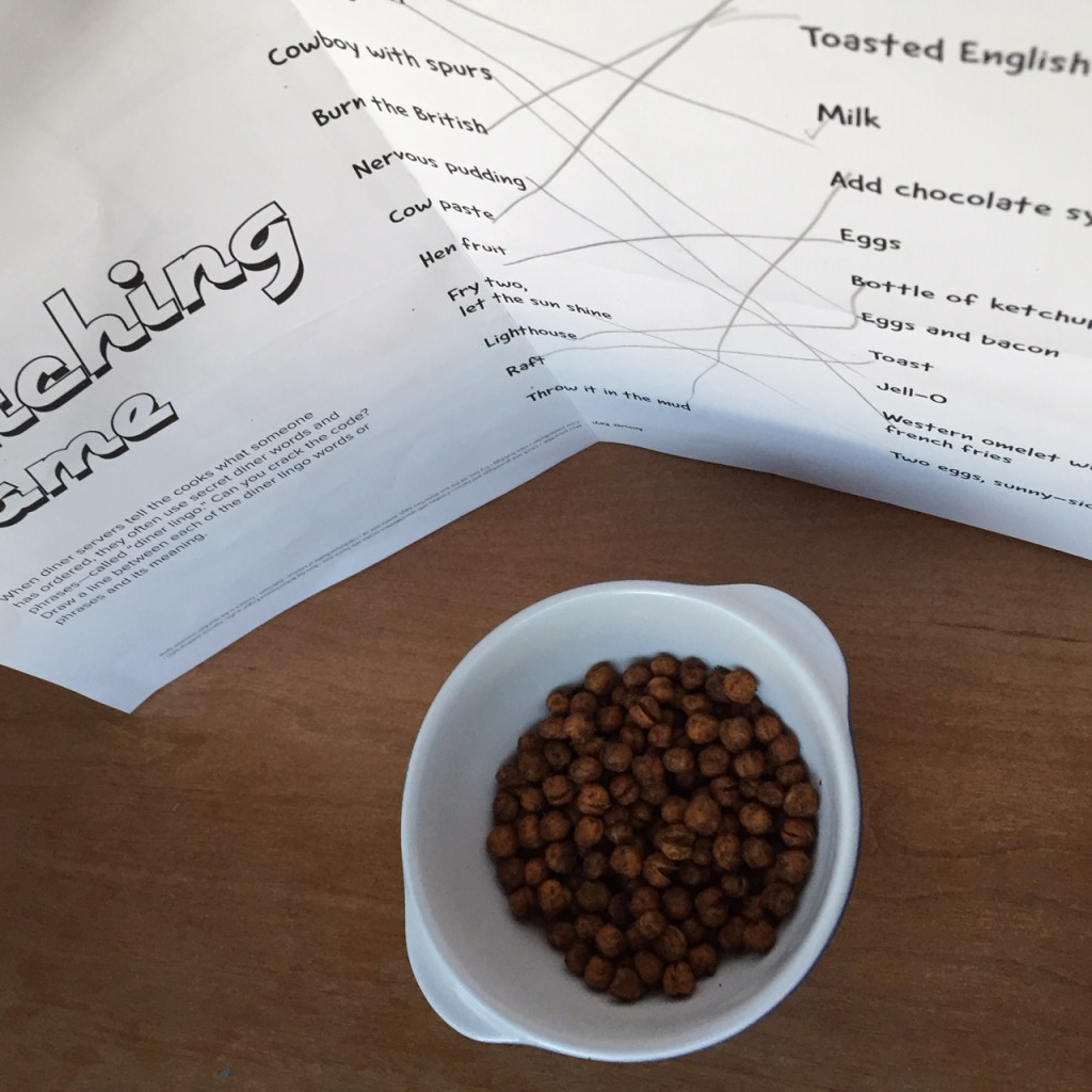 the bowl of spiced chickpeas with a white piece of paper reflecting light back on the bowl