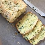 the loaf of slightly sweet cheese and kale bread, three slices, and a knife