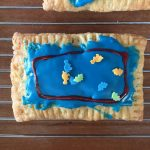 a nutella pop tart decorated like dinosaurs in a fish tank