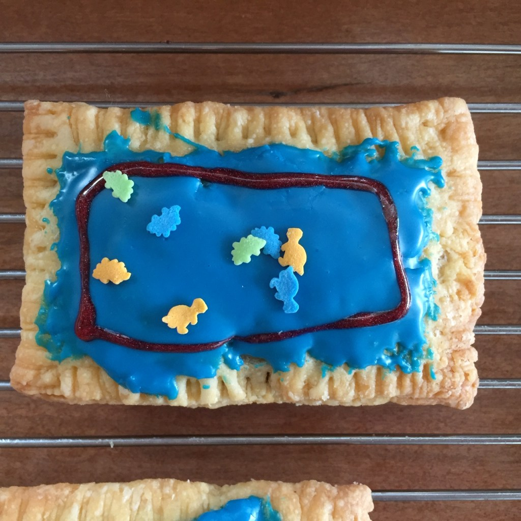 a nutella pop tart on a baking rack decorated like dinosaurs in a fish tank