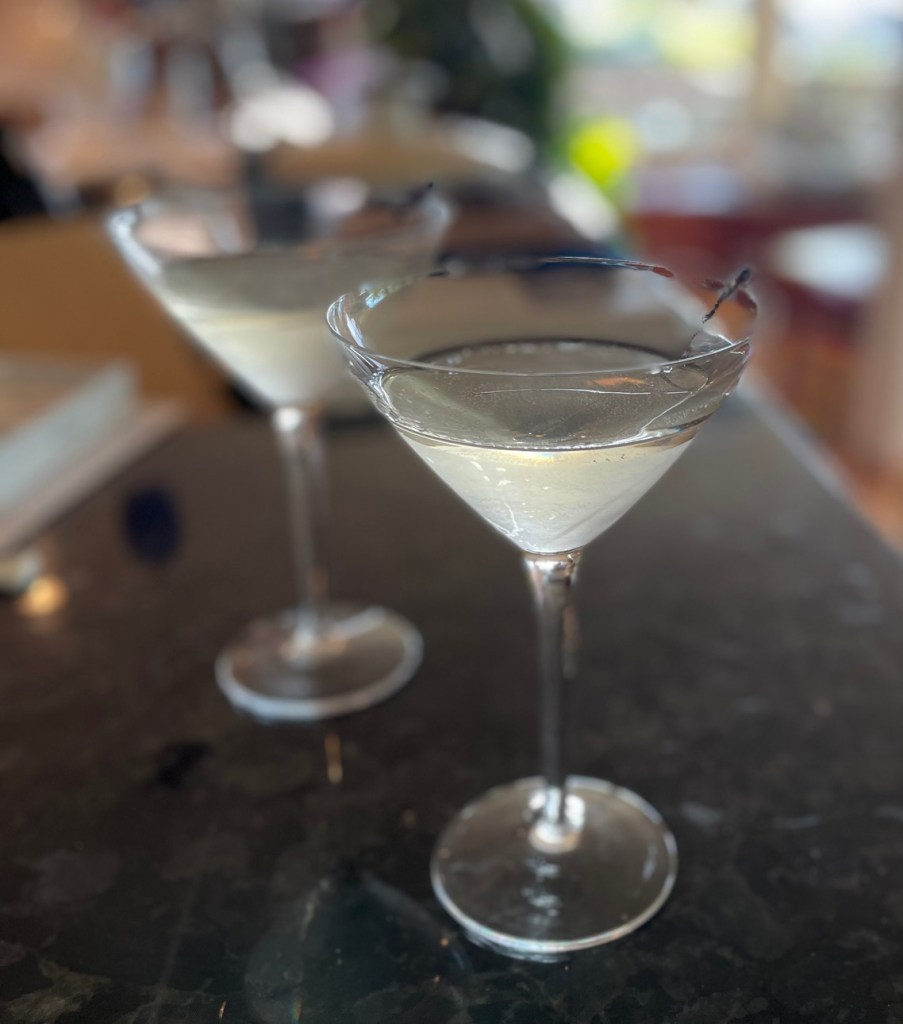 two cocktails in martini glasses