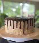 a peanut butter chocolate drip cake