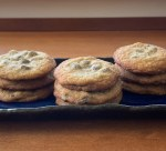 a plate with three stacks of three chocolate chip cookies each