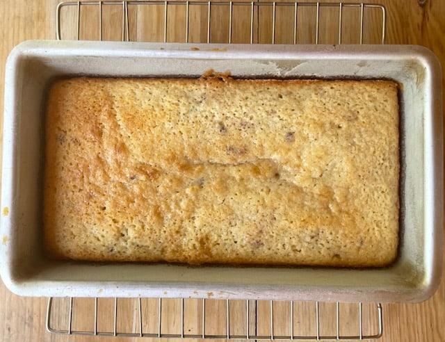 the baked blackberry lemon loaf still in the loaf pan