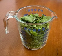spinach in a two cup glass measuring cup