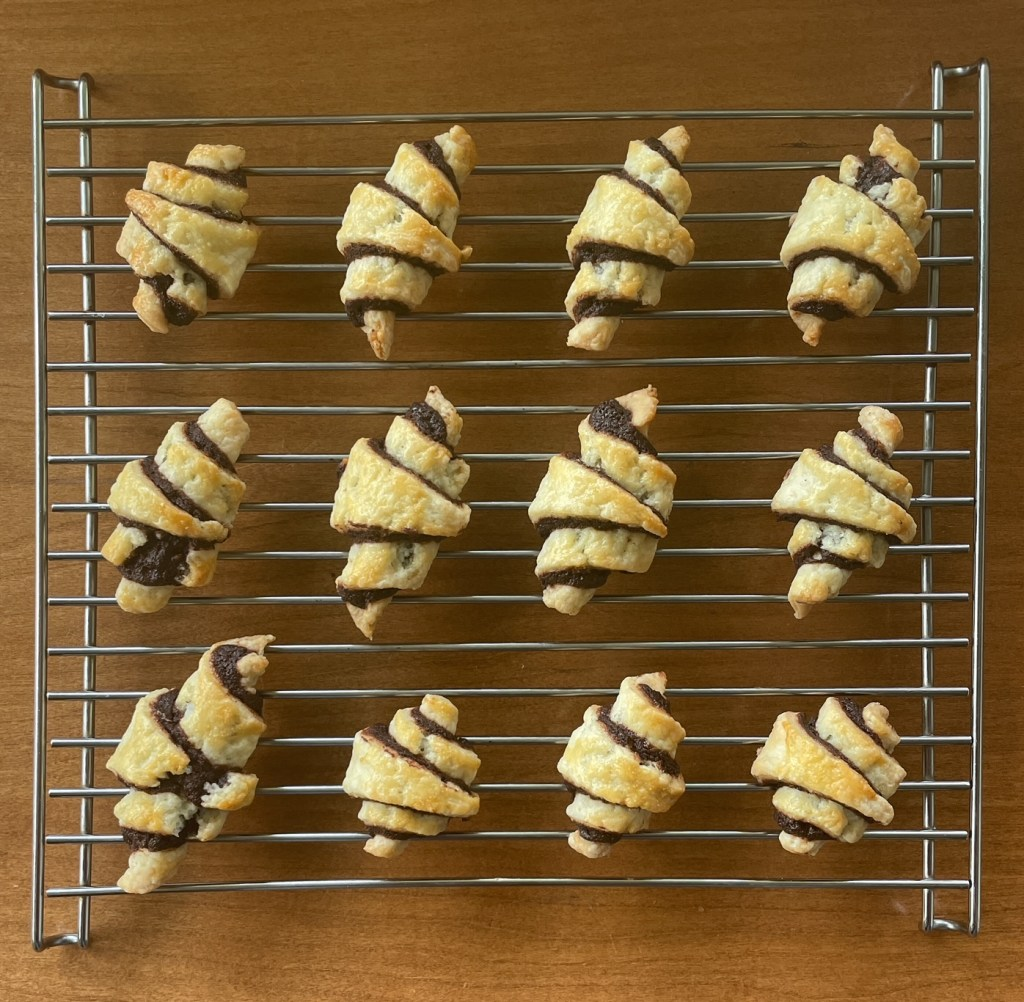 baked chocolate rugelach on a cooling rack