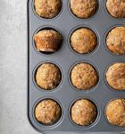 a tray of mini banana muffins with coconut