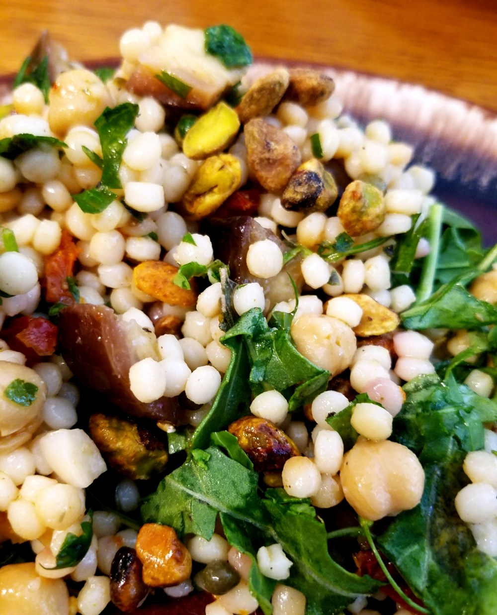 Served over a bed of arugula and topped with roasted pistachios