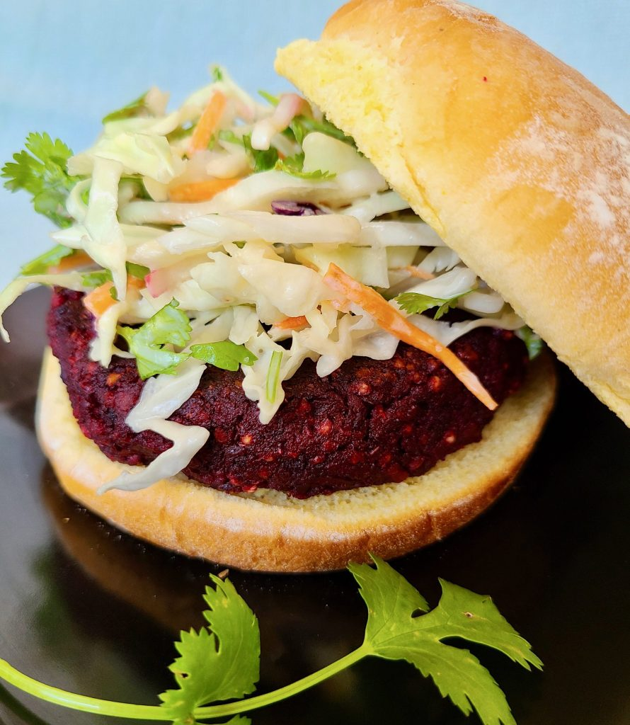 Homemade Beet Chorizo Burger topped with vegan creamy cilantro coleslaw