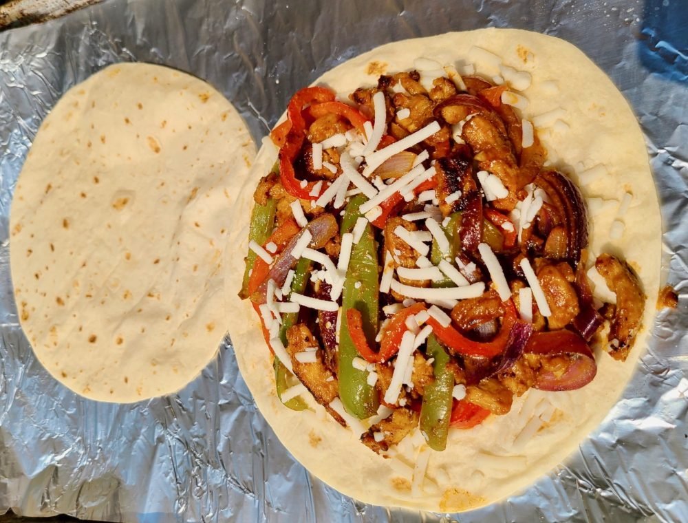 Tortillas on the grill with soy curls and vegan cheese