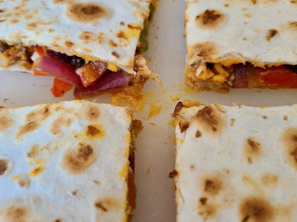 Vegan quesadilla cut in four pieces