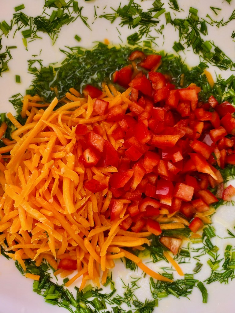 Vegan Lemon Dill-Chive Dressing with shredded carrots and chopped red bell pepper