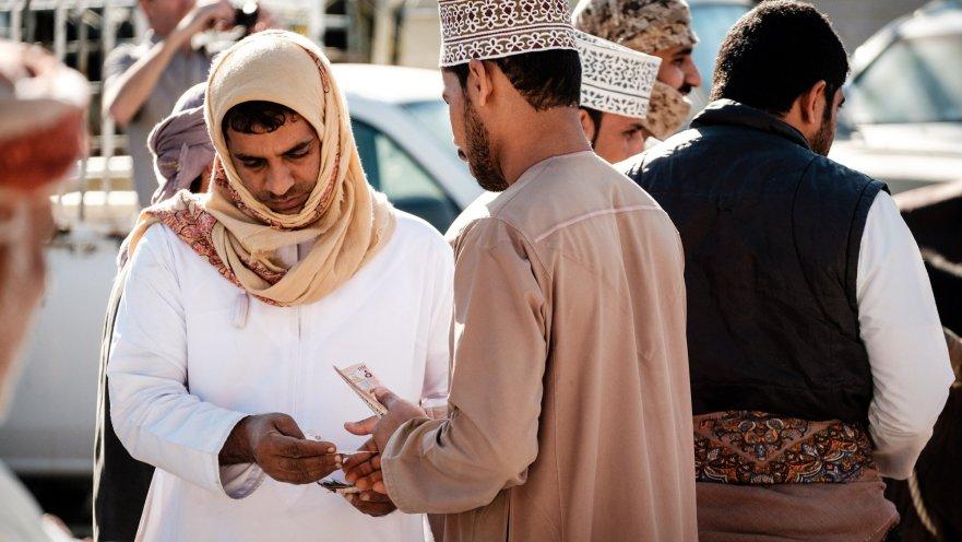 Money changing hands at Nizwa market, Oman