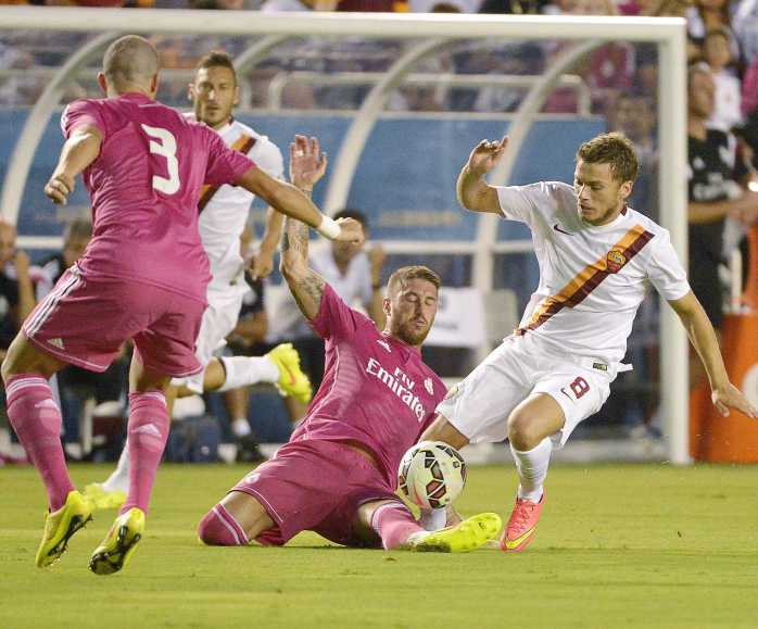 Real Madrid (in maroon) hopes to repeat last year's success (Max Faulkner/Fort Worth Star-Telegram/MCT)