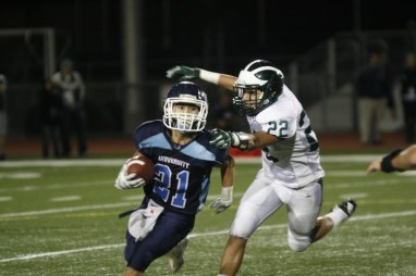 Matt Abellaneda (#21) ended the season leading the Trojans in rushing yards and touchdowns with 365 yards and seven touchdowns (Jerry Park)