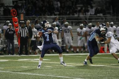 Quarterback Wes Jordan (#7), who recently recovered from a concussion, passes to a teammate (Jerry Park)