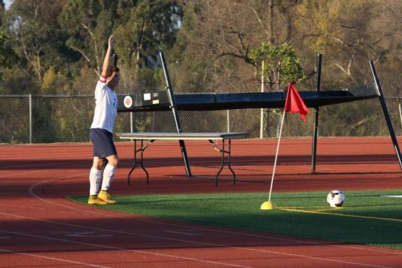 Tommy Levasseur (Sr.) prepares to make a corner kick in the Thursday game against Warren (Shirin Aminian)