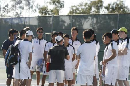 The team surrounds coach John Kessler (center) during the March 5th match against Peninsula. (Alexander Chang)