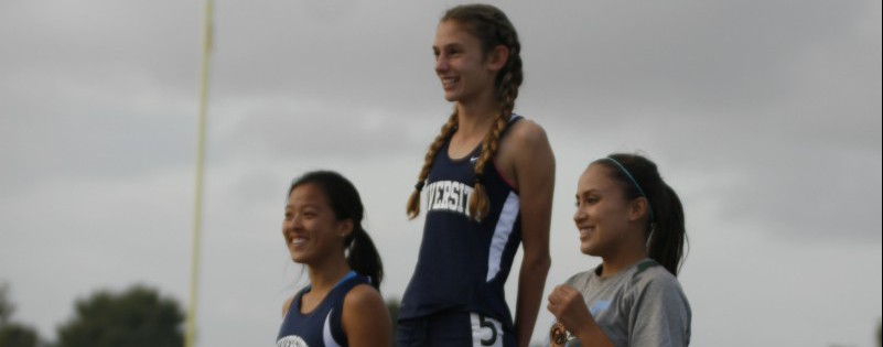 Paige Metayer (Fr.) and Carmel Lee (Jr.) placed first and second in the 400m. Both runners qualified for CIF. (Zoe Berger)