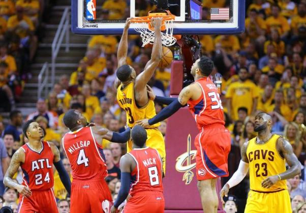 Cleveland Cavaliers' Tristan Thompson gets past Atlanta Hawks defenders Kent Bazemore, from left, Paul Millsap, Shelvin Mack and Mike Scott for the slam with LeBron James looking on during Game 4 of the Eastern Conference Finals. (Curtis Compton/Atlanta Journal-Constitution/TNS)